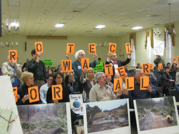 """PROTECT WATER FOR ALL,"" says the crowd, representing 67 organizations petitioning the DRBC to stop abdicating its authority over fracked gas pipelines; ""NOT THE PROFITS OF A FEW,"" the crowd spells out on the other side of the room. DRBC meeting, West Trenton, NJ March 6 2013. Photo: Iris Marie Bloom"