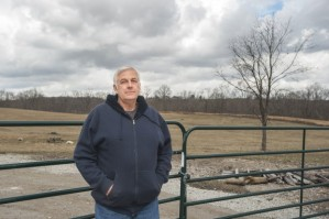 David Headley stands outside the locked gate that leads to his 115-acre farm in Springhill Township. Headley contends that Atlas Resource Partners has locked the gate, forcing him to use an alternate means to access his property and home. Photo by  Roberto M. Esquivel