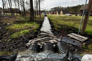 Crude oil flowed down driveways and swamped grass lawns in Mayflower, Arkansas, after an oil pipeline ruptured Friday afternoon - National Geographic, Photograph by Jacob Slaton, Reuters