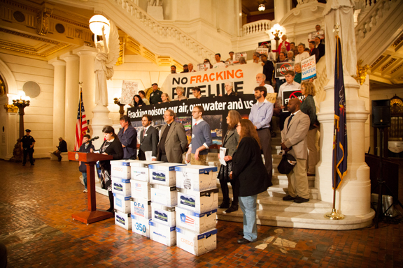 """No Fracking Pipelines"" says a Protecting Our Waters banner in Harrisburg yesterday. Karen Feridun of Berks Gas Truth is standing bottom right; Ljubica Sarafov of Democracy for America is speaking. Photo: Keely Kernan"