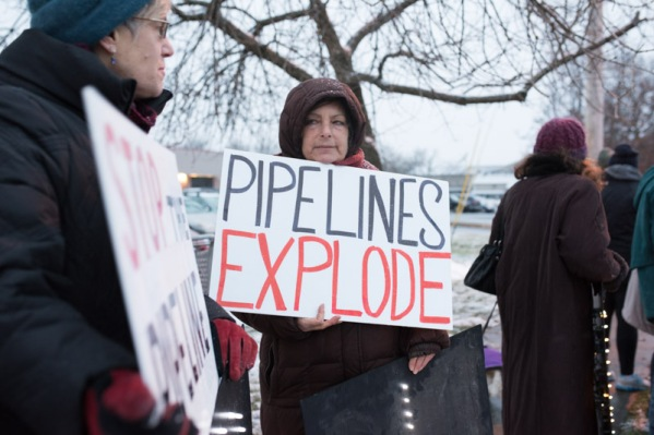 Pipelines Explode... and leak, and harm climate, say demonstrators against Pilgrim Pipeline. Photo: Jodiah Jacobs